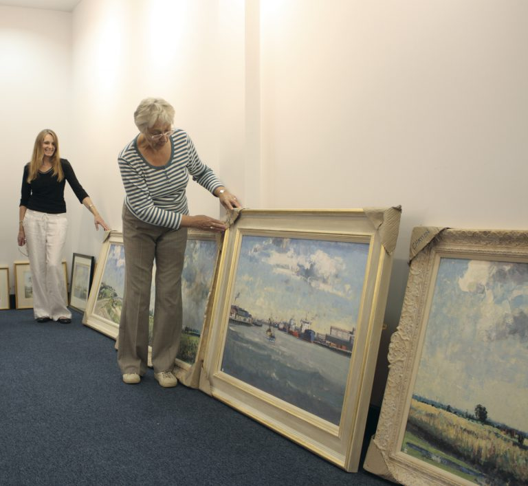 Susan Marshall (left) and Margaret Carver prior to hanging the annual exhibition